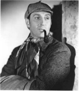 Basil Rathbone as the iconic Sherlock Holmes.