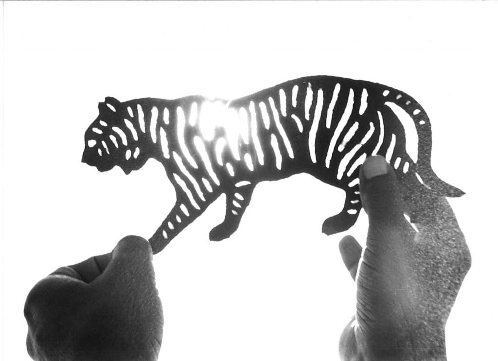 A torn-paper tiger, created by silhouette artist Gordon Vales