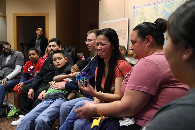 Parents and kids at a 2013 Family Reading event in Shoreline. The program brings families together over storytelling.