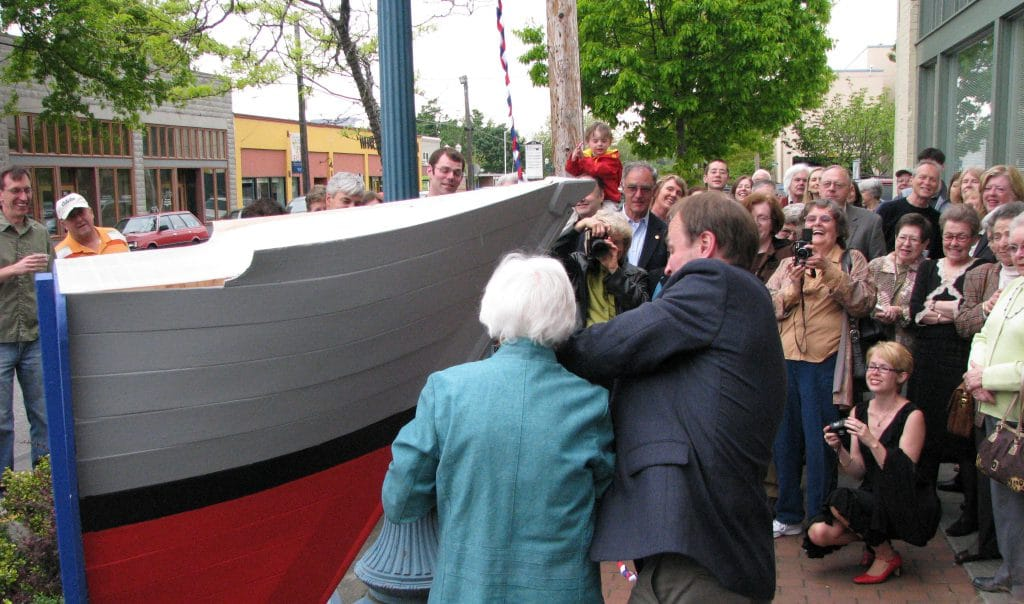 A symbolic ship is christened at the the opening of Whatcom Museum's World of the Shipwright exhibit. The exhibit included oral histories from community members | Courtesy the Whatcom Museum
