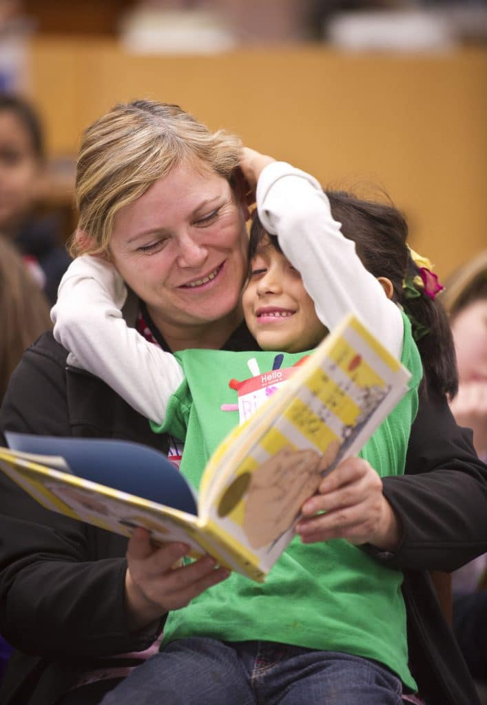 Families at the Spokane County Library read A Sick Day for Amos McGee together at a Prime Time session last Fall.